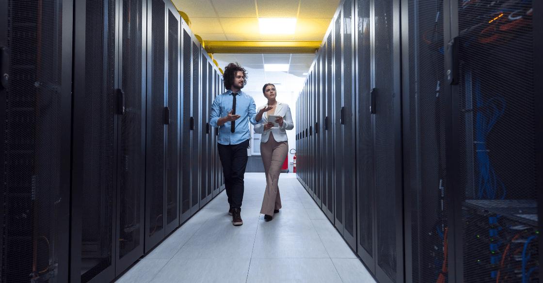 Man and woman walking through server room