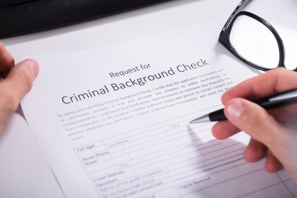 Personal filing out a criminal background check