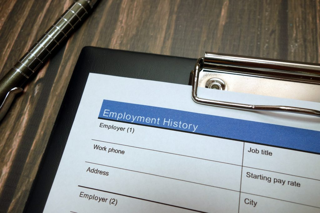 Employment history document, job application form with pen