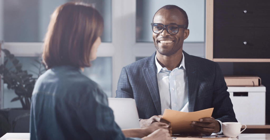 Happy employer interviews job applicant he found to be qualified by checking her social media as part of a background check.