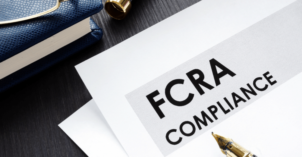 FCRA compliance form sits on the desk of an HR manager as they review their human resources background check policy.