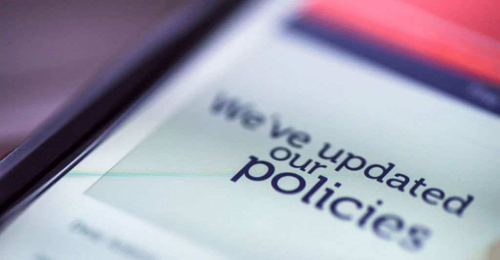 A digital notification regarding a company's updated background check policy.