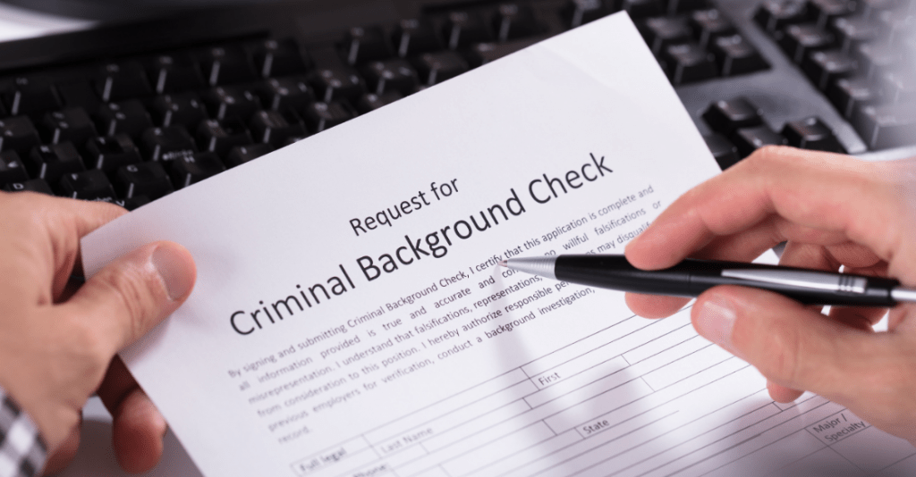 Employee filling out a criminal background check application form after an offer as per Ban the Box laws.