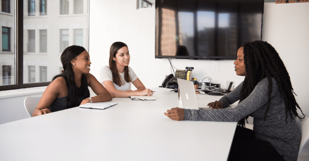Prospective employees interview with a hiring manager.